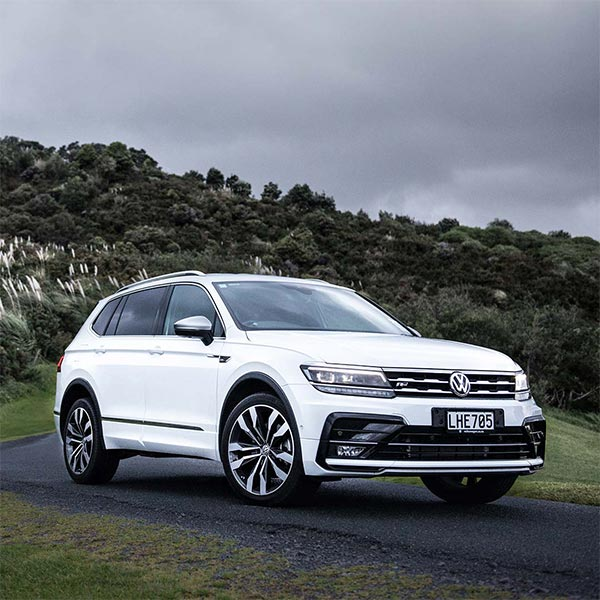 VW Tiguan Allspace R-Line in white on a road