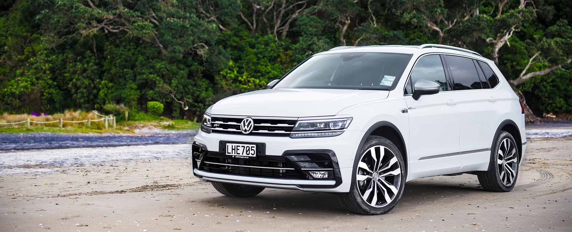 Volkswagen Tiguan Allspace R-Line SUV in white on a beach