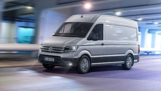 Volkswagen Crafter Van driving with headlights