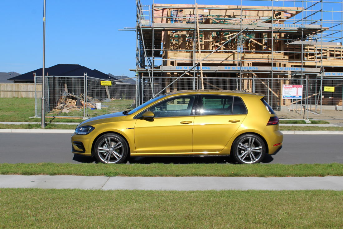 Side photo of the Golf R-Line in Turmeric